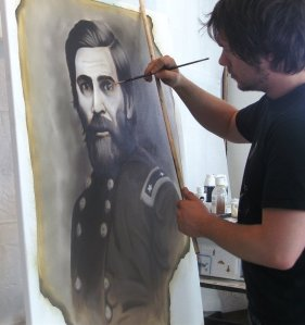 Local artist Forrest King working on his Cheyenne project